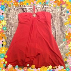 HP 4/26/15 Coral Jeweled Bebe Halter Girly Girl HP on 4/26/15 by @dawncochran Great new Spring 2015 color!!! Beautiful silky coral colored halter top in great condition. No stains, rips or damage. Ties at neck. Sz small but fits up to a small busted sz 6-8.  PLEASE ASK ALL QUESTIONS PRIOR TO PURCHASE. NO RETURNS. ✂️Price Cut 2/6/15✂️ bebe Tops