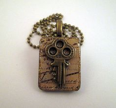 GOOD LUCK KEY Unisex Collage Pendant With Antiqued by Garnishments, $22.50