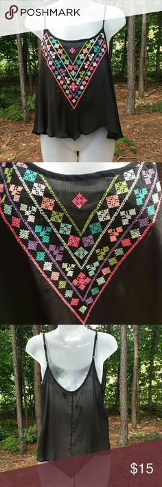 Black Aztec Design Crop Tank NWT! 100% rayon Neon Aztec design black flowy crop tank with adjustable straps. It's slightly sheer but not where the design is. This is a beltline crop. Rue 21 Tops Crop Tops
