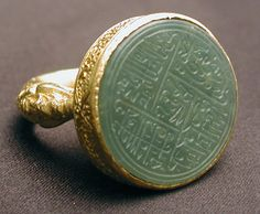 """Seal ring with inscription Iran or Central Asia, late 15th-early 16th century """" This magnificent gold ring holds a jade stone engraved with religious verses"""
