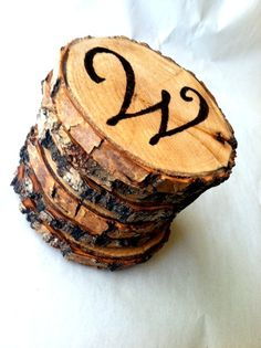 Rustic Tree Branch Coasters with Woodburned Design. Could also do house numbers.