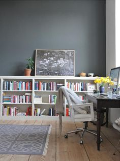 IKEA billy bookshelf hack in their 'library'. Dark grey wall. A Beautiful Country Home in Rural Germany | Design*Sponge