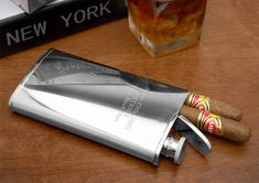 This Cigar Flask comes with a cigar storage compartment, Cool. The flask features a compartment sized .75″ by 1.5″, and fits 2 46-ring cigars. On the other side, you'll fit 4 oz. of liquor.