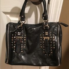 Nine West Studded Handbag Faux leather with silver studs. Bag still looks great. Price is negotiable. Feel free to make an offer. Nine West Bags Satchels