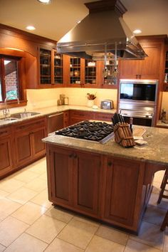 Small Kitchen Islands Design Ideas - would kind of like a small island with induction stove top and a double over like this.
