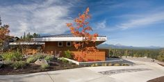 CONTEMPORARY HOME WITH METAL ROOF BY HANSMANN CONSTRUCTION