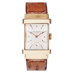 "PATEK PHILIPPE Rare ""TOP HAT"" Yellow Gold Wristwatch    Estate  This is an iconic example of a vintage Patek! Although it is likely too modest in size for many modern gentlemen, this would make a lovely lady's watch and is an outstanding overall example in 18k yellow gold. The rectangular shape of the case is charming and the watch is in absolutely mint condition, with clean and distinct hallmarks."