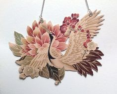 Crane and flower necklace. This would be a good tattoo for my character Adele