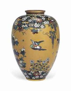 A Cloisonné Vase  Meiji period (late 19th century)  Worked in gold and silver wire and decorated in various coloured enamels with birds amongst wisteria and chrysanthemums on an ochre ground, copper rims