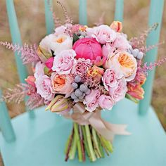 Blooms and BerriesThe organized garden bouquet is one of the prettiest floral trends this year. If you love the informal nature of mixing roses, peonies, tulips, berries and feathery astilbes, but still want your bouquet to be neatly pieced together, ask for a tight arrangement of these blooms—it's the combination of the flowers that gives a casual vibe, not the way it's tied together.