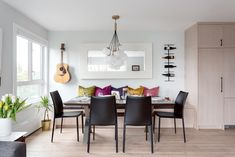 We made over this dining room as part of a full condo renovation on East 6th Avenue, Vancouver. Designed by Madeleine Design Group. *Re-pin to your own inspiration board* Contemporary Design, Modern Design, Dining Area, Dining Room, Small Condo, Bright Walls, Banquette Seating, Oak Cabinets, Large Windows