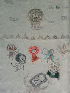 A Buddha and dancing lions with lions masks. Hand embroidered by MIGA DE PAN