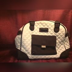 Beige&Chocolate Vera Bradley Purse Like New!!!! This has hardly been used and is in excellent condition with no visible signs of wear! The outside is a light beige quilted fabric with dark brown straps. Magnetic closure on side pocket zipper closure on opening. Vera Bradley Bags