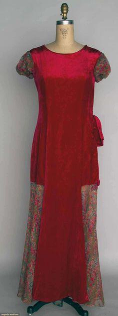 "VELVET & CHIFFON EVENING DRESS, 1920s Cherry red silk velvet, floral printed chiffon skirt gores & cap sleeves, B 38"", W 34"", L 57"", (1"" mark in velvet skirt front, underarm discolorations) fair."