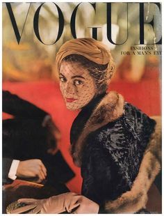 carmen-dell_orefice-looking-regal-in-a-veiled-hat-on-the-cover-of-vogue-1948