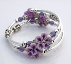 Embraceling Bracelet - Lavender Flower polymer clay beads. $25.00, via Etsy.