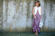 White denim vest paired with a maxi dress. Maxi dresses are so in this summer! #fashion #summer