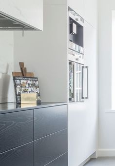 Functional and aesthetic harmony in this kitchen - clean lines, black and white theme and real woodwork. Beautiful finish!