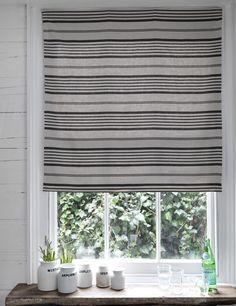 Jolly Stripe Fabric A vintage inspired linen fabric with stripes of varying widths, printed in charcoal grey and black on a natural ground.