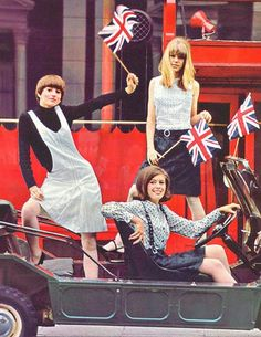 Jenny In London    Summer 1965 - American teen Stephanie Sikorski (seated in car), of Allentown, PA, won an eight day trip to England sponsored by Hess's Department store. On Wednesday Stephanie was off to a big party with London models Gai Wright and Jenny Boyd all shown posing in Mary Quant fashions. Jenny Boyd is wearing a shirt-dress by Mary Quant for Daphne, $25. From Ingenue magazine, November 1965.