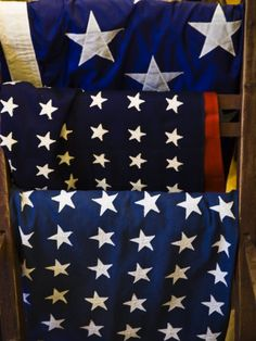 Us Flags Folded and Hanging from a Wooden Rack