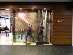 Nike trail running retail window display sports shoe and apparel display.