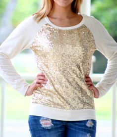 Ivory Sequined Sweater from Tara Lynn's..  Who doesn't love a sequined shirt!