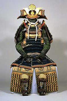 Domaru Armor with Dark Blue Lacing, Helmet and Wide Arm-Protectors.Domaru-style armor was worn by foot soldiers. This style of armor encircles the soldier's body with the edges and is fastened on the right side. Unlike the oyoroi-style armor used by officers, domaru armor was relatively easy to wear; the kusazuri skirts were divided into at least five sections to allow freedom of movement of the legs and hips.