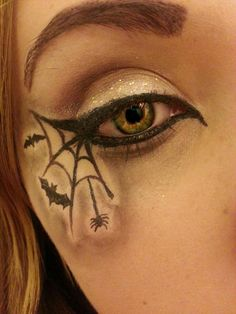 Simple makeup for halloween using eyeliner and white eye shadow