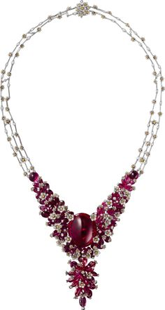 CARTIER. Necklace - white gold, one 62.15-carat oval-shaped cabochon-cut rubellite, three cabochon-cut rubellites totaling 9.90 carats, rubellite beads, orange and white brilliant-cut diamonds. The tassel is removable. #Cartier #CartierMagicien #HauteJoaillerie #FineJewelry #Rubellite #Diamond