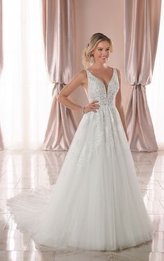 600ebfed8cbb Layers of crinoline keep the shape of this perfectly bell shaped tulle  skirt. This gown