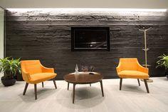 shou sugi ban charred wood accent wall, orange accent chairs