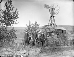Circa 1887. Family with their sod house in Custer County, Nebraska. Solomon D. Butcher [Nebraska State Historical Society - nbhips 12674] http://www.loc.gov #American #History #Nebraska -- Note: This family looks to be doing quite well from the looks of their clothing, the windmill, and all the doors and windows on their soddy.