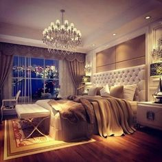 Beautiful romantic bedroom with chandelier, tufted headboard, and neutral color palette featuring soft grey.
