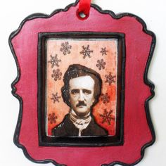 """Add a gothic flair to your Christmas decor with this Edgar Allan Poe ornament. Ive hand painted this ceramic ornament red with black trim. I added a digitally altered picture of Poe on a distressed red background with black snowflakes floating around him. I layered a second picture over the original on a foam base for a 3D look. This is the perfect ornament for your spooky holiday decor! Approximate Dimensions: 4T x 3 1/4W x 3/8""""D    I WILL REFUND ANY OVERAGES OVER A $1.00 FOR ALL ORDERS. I…"""