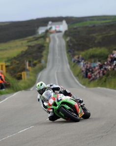 TT. Michael Dunlop rides his Kawasaki in the Superstock class coming into to Creg na baa