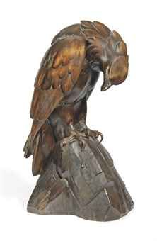 A Swiss 'Black Forest' carved wood model of an eagle