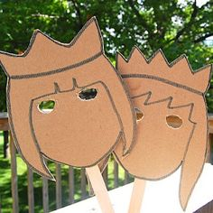 Kings and Queens! Masks made from cardboard and Popsicle sticks.