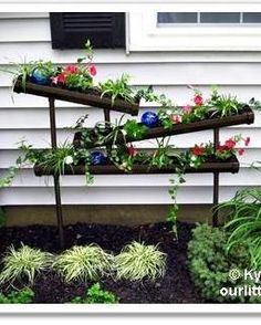 A Different Angle on Vertical Gardening would be cool for miniature gardens.....