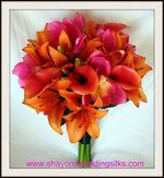 A beautiful bouquet... pink calla lilys and orange lilys.