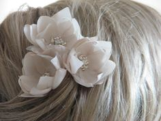 Chic and very delicate hair flowers made of quality fabrics in cream, champagne and ivory.  Flowers diameter is approx. 2 and are attached to bobby pins.  I like very much custom orders. Please send me details regarding your needs. I can offer you a special price for larger orders.  If you have any questions, you do not hesitate to contact with me.  All flowers are hand formed by me to the last detail and using quality fabrics. I create all my adornments with love and great passion…