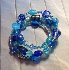 Aqua and blue glass beaded memory wire bangle bracelet.