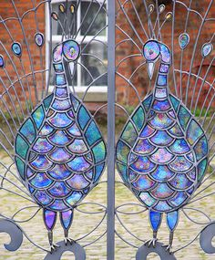 Peacock wrought iron gates