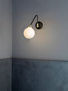 The Array Single Opal is a wall lamp proposed by CTO Lighting. It is composed by a bronze frame with satin brass details and opal shade. Custom Lighting, Modern Lighting, Luxury Lighting, Lighting Ideas, Contemporary Light Fixtures, Ball Lights, Glass Diffuser, Inspiration Wall, Diffused Light