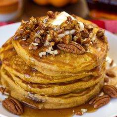 Light and fluffy pumpkin pancakes with homemade buttered pecan maple syrup! Perfect for fall!