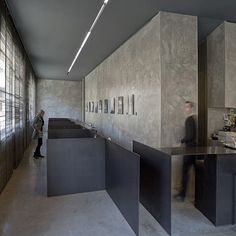 Located in Olot, north-east Spain, the 6T7 Espai Cafe has bare concrete walls and flooring.