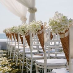 Love these long woven petal cones full of white orchids by @luxuryeventsphuket