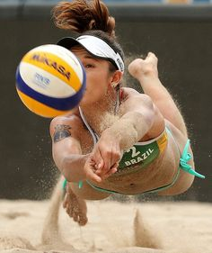 Barbara Seixas of Brazil plays a shot during match against Liliana Fernandez and Elsa Baquerizo of Spain during the 2015 Swatch FIVB World Tour Finals on Fort Lauderdale Beach in Florida. Mike Ehrmann, Getty Images for FIVB Beach Volleyball Girls, Women Volleyball, Volleyball Clothes, Laura Ludwig, Foto Sport, Athletic Girls, Athletic Models, Beach Games, Female Volleyball Players