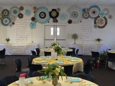 Decorations for a church's 50th anniversary celebration. Gold w/turquoise accents. Back wall, giant handmade pinwheels in the accent colors. Hang balloons around the perimeter with pictures glued to the ends of the ribbons. Very festive