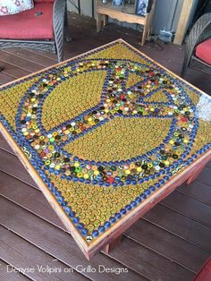 The design on this table is awesome and what makes it even better? It's made from recycled bottle and beer caps.